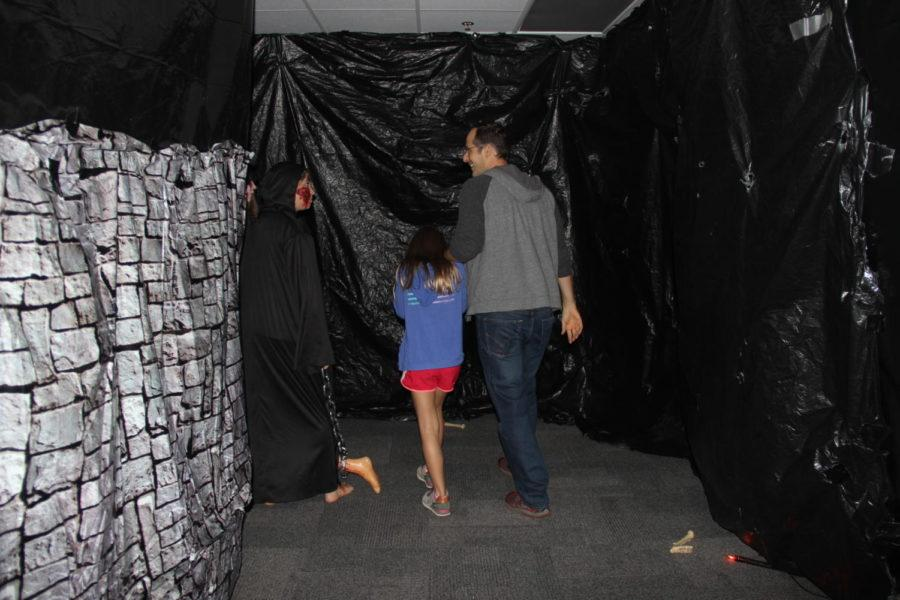 Attendees of the Fall Festival at New Tech High@Coppell on Oct. 26 enter the haunted house at the festival. All proceeds from the haunted house and festival were donated to the Leukemia & Lymphoma Society.
