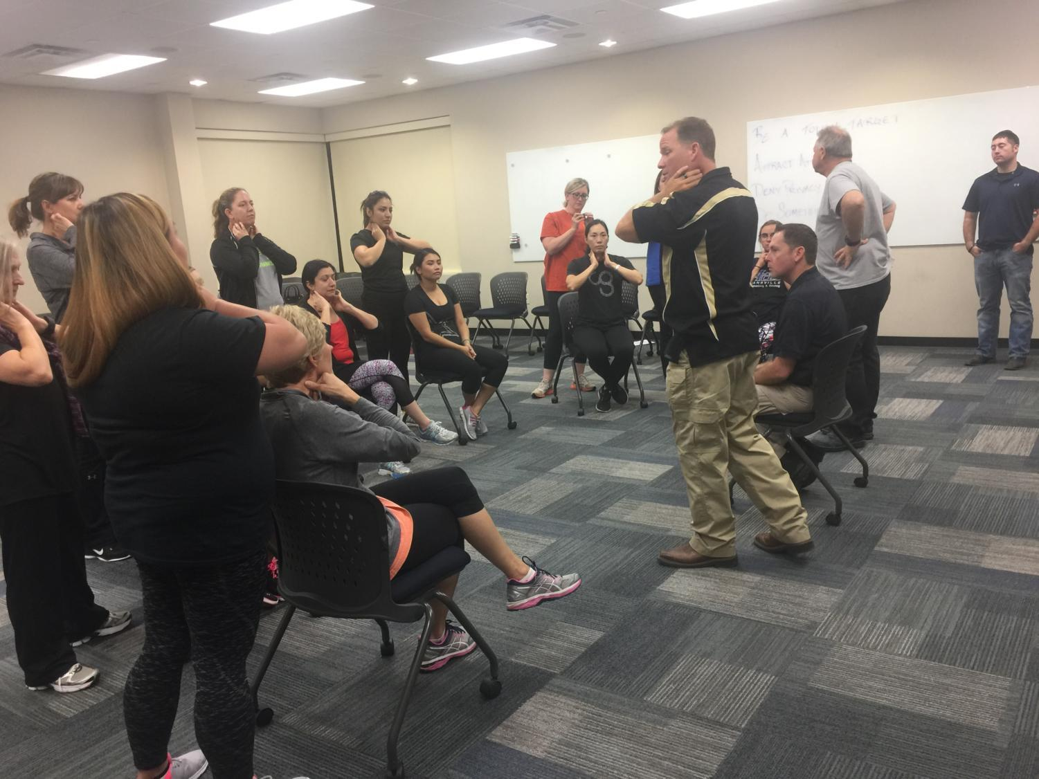 The 14 girls participating in the women's self defense class practice using pressure points. Pressure points can knock out the attacker with a simple hit. The classes take place at the Coppell Police Department on Wednesday's from 6:30 - 8 p.m.