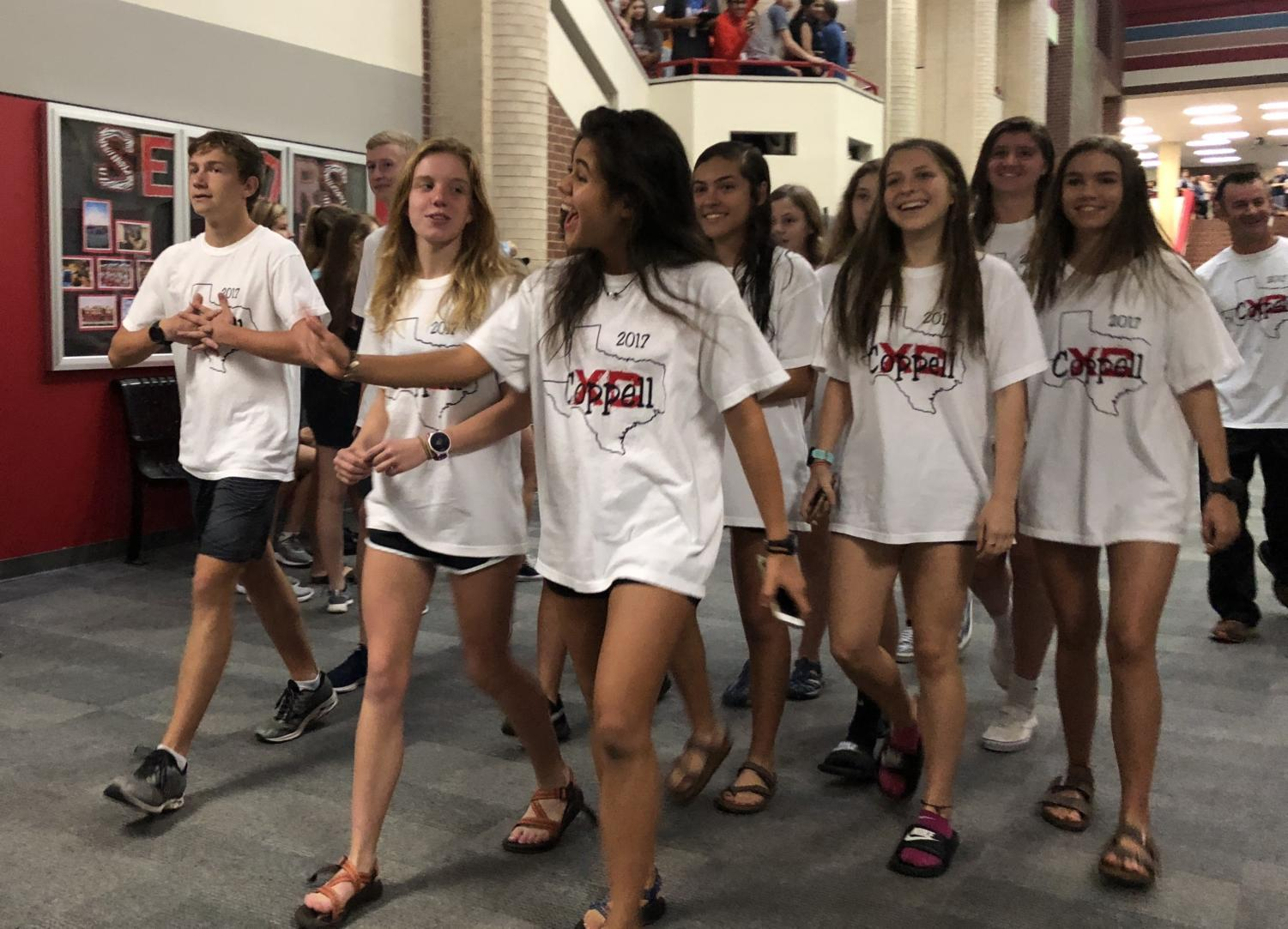 The Coppell High School cross country team had a successful season with the girls team claiming the Class 6A Region II championship. Today during first period, the team walked down the main CHS hallway for their state send-off.