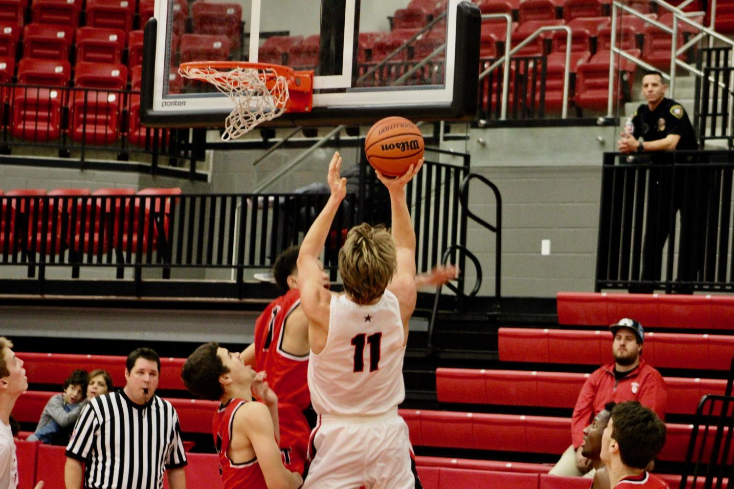 Coppell High School senior small forward Kevin Galvin shoots a layup during the game against the Trinity Trojans at the Coppell High School Arena on Nov. 29. The Coppell Cowboys defeated the Trinity Trojans, 58-49.