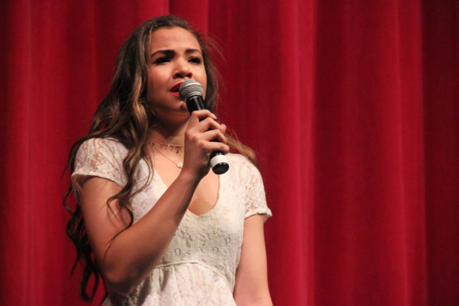 Coppell High School junior Kealani Garrett sings a solo for the second performance of the night. Coppell High School girls choir performs their second performance of the Respira Dessert Show Saturday night in the auditorium.