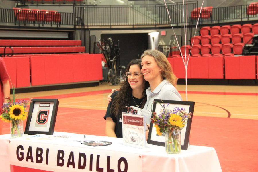 Coppell+High+School+senior+Gabi+Badillo+smiles+for+the+camera+with+her+coach+after+signing+with+Oklahoma+Christian+University+on+National+Signing+Day.+Students+are+signing+their+letters+of+intent+for+the+college+they+intend+to+play+for+in+the+upcoming+year.%0A