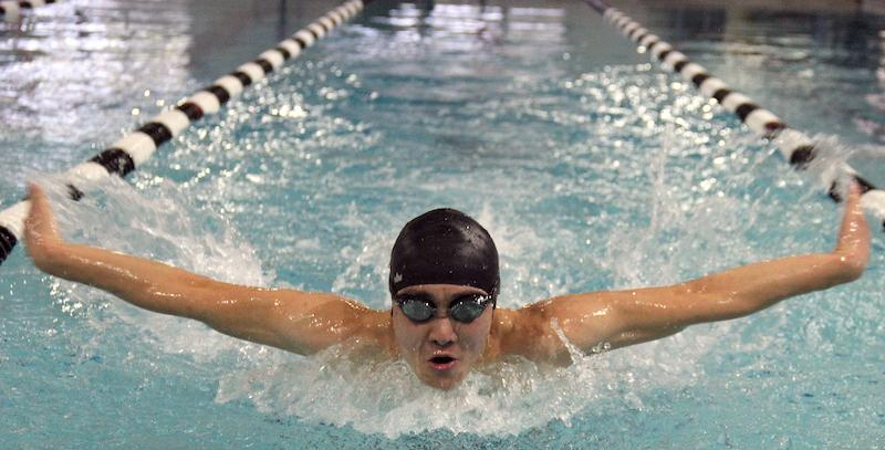 Coppell High School senior Daniel Chang practices his butterfly stroke on Tuesday at the YMCA, where the swim team practices every morning. Chang transitioned from taekwondo to swimming at the start of his junior year.