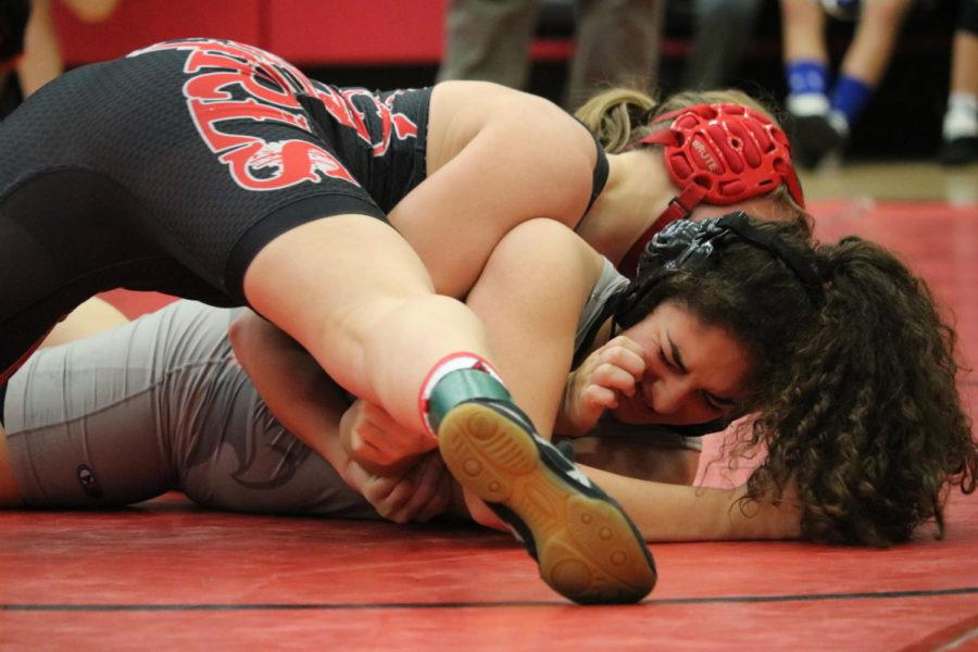 New Tech sophomore Brooke Massavoil pins her opponent from Liberty High School in Friday afternoon's wrestling match. The girls wrestling teams had the Knockout Sportswear Cowgirl Classic Dec. 1 in the arena.