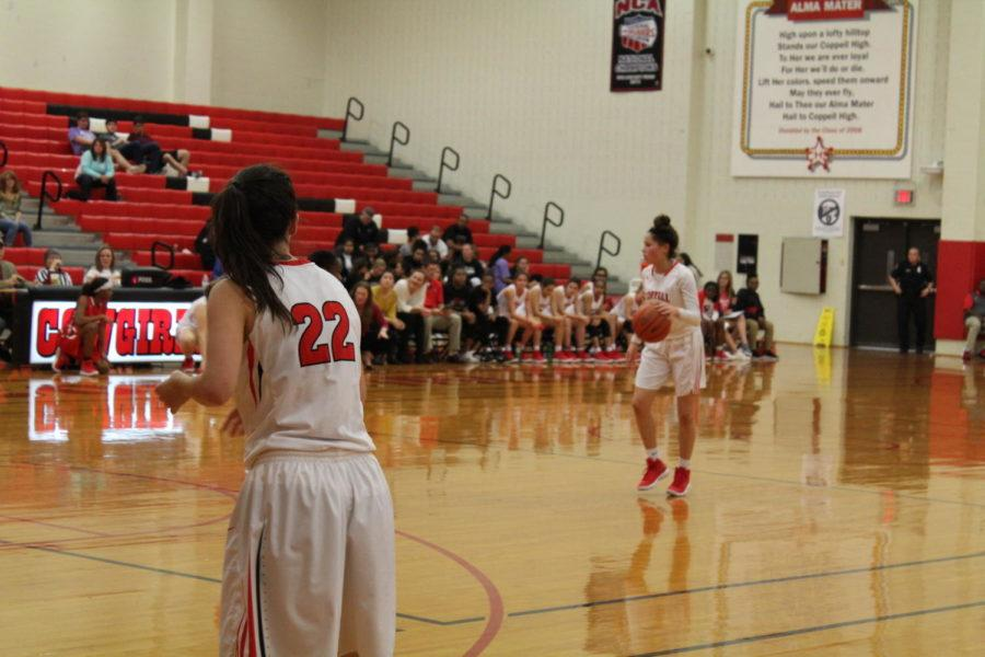 Coppell sophomore guard Kennedi Rogers and the rest of the Cowgirls play offense against Lake Highlands Friday night at CHS. Coppell opened District 9-6A play with a 40-32 victory over the Lady Wildcats.