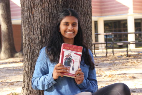 Sidekick staff writer Pramika Kadari holds a copy of The Overachievers by Alexandra Robbins. The Overachievers is a nonfiction book that explores the problematic pressures of today's society, focusing on eight high school and college students' lives.