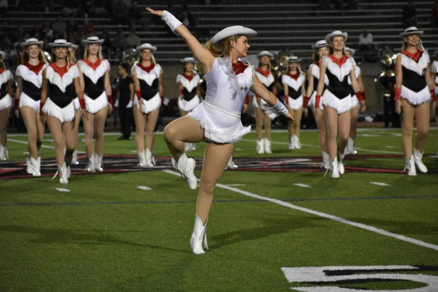CHS senior Kristen Lason performs during halftime at Allen Eagle Stadium during the Allen vs Coppell on Sept. 29. Lason is a captain of the Lariettes and hopes to continue dancing throughout college.