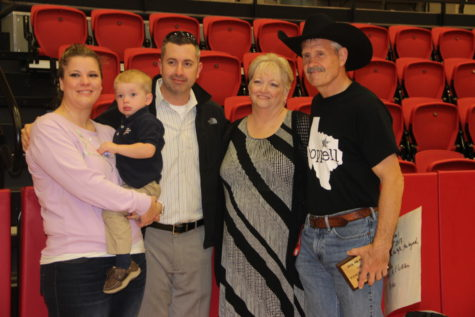 The family of Coppell High School weightlifting coach and outdoor adventures teacher Bill Parker supports him at the Teacher of the Year ceremony in the CHS Arena on Dec. 4. Bill Parker was awarded as Teacher of the Year for 2017 for his exemplary work ethic and success as a teacher and coach.
