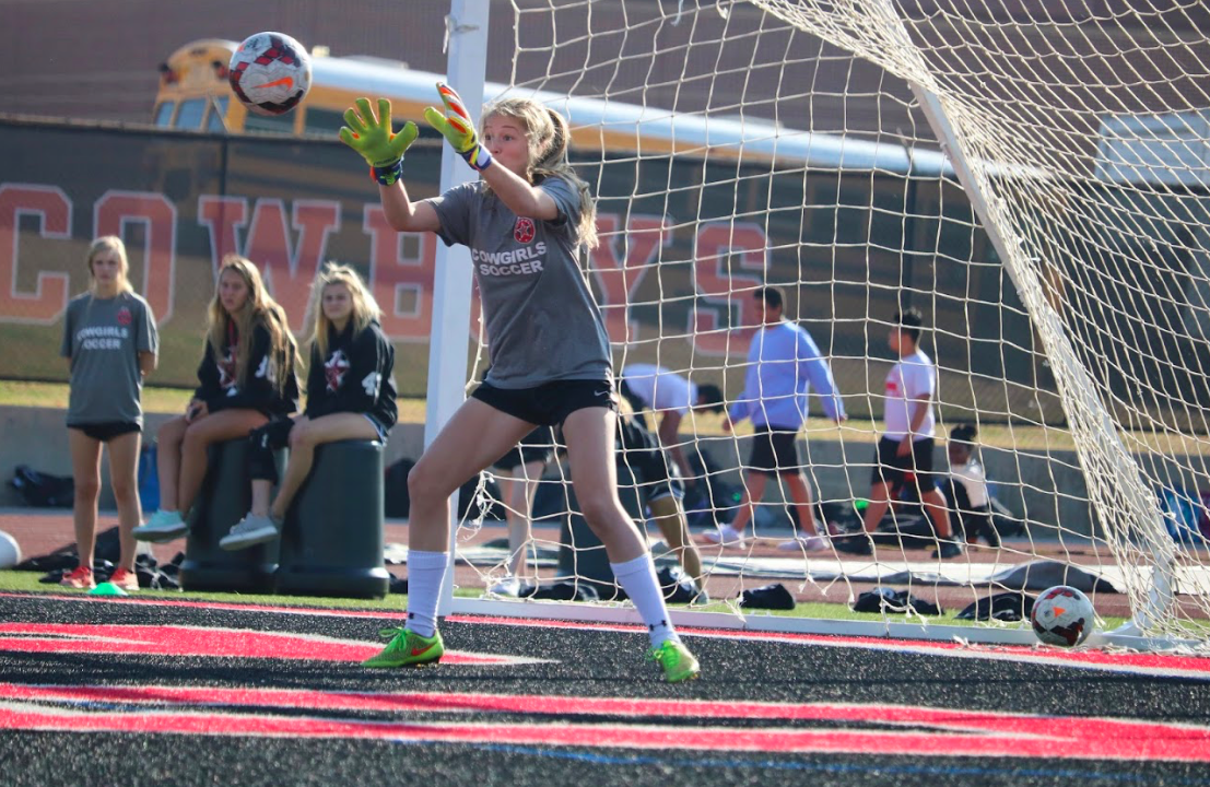 Sophomore Lauren Kellet, goalie on the CHS varsity girl's soccer team, saving a ball during practice on December 1. Lauren committed to TCU earlier this year.