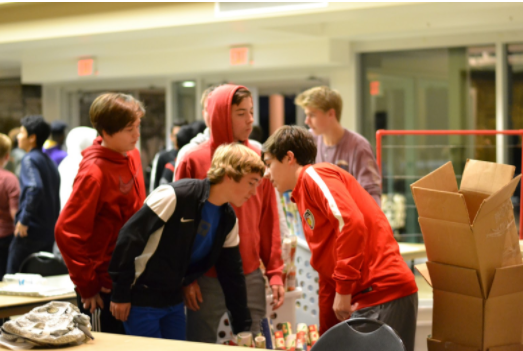 Coppell Cowboys soccer team volunteers to carry boxes of wrapping paper and other supplies on Dec. 6 at Valley Ranch Baptist Church in order to pack toys for children in need. Coppell High School JV and Varsity soccer teams volunteered to help give back to the local community and disadvantaged children.
