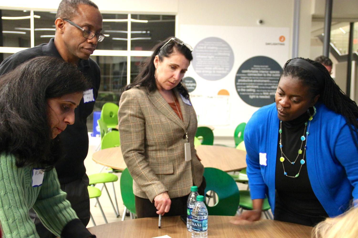 Valley Ranch PTO Board co-president Ritu Sethi, Coppell ISD Trustee Anthony Hill, Executive Director of Teaching and Learning Deana Dynis and Dean of Public Health at West Coast University Sharonda Wallace sort through question cards based on their thoughts on education at the first Educational Summit at Richard J. Lee Elementary on Thursday night. This card sort is one of the activities that will allow Coppell ISD to analyze feedback for their strategic design efforts.