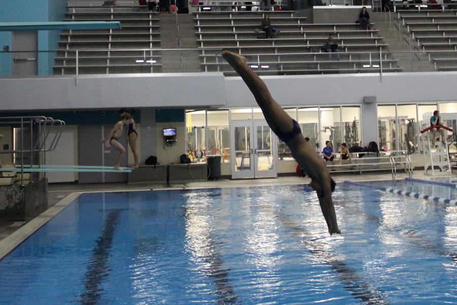 Coppell+High+School+sophomore+Ethan+Koshy+practices+diving+off+of+the+three-meter+platform+at+Westside+Aquatic+Center+in+Lewisville+on+Dec.+6.+Koshy+is+the+only+diver+on+the+CHS+swimming+and+diving+team+and+outside+of+school+is+on+the+No.+1+diving+team%2C+GC+Divers%2C+in+the+nation.+Photo+by+Lili+Lomas.%0A