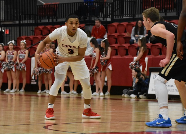 Coppell High School junior Tariq Aman dribbles down the court during Tuesday night's game in the CHS arena. The Cowboys defeated the Jesuit Rangers 63-55, to improve its record to 20-9 on the season.