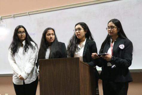 Coppell High School HOSA members, sophomore Vyshnavi Nalla, sophomore Isha Agarwal, sophomore Hima Cheruvu and sophomore Athira Suresh, present their medical topic of drug and substance abuse in the lecture hall on Thursday in the Lecture Hall. About 40 teams of the club prepare for their upcoming competitions in February.