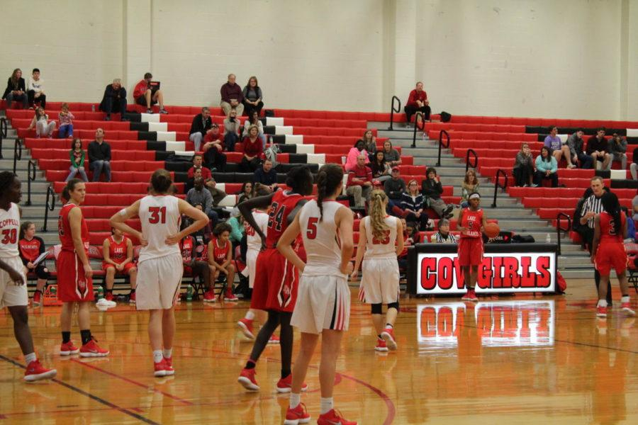 Coppell+High+School+sophomore+Chloe+Hassman+and+the+rest+of+the+Cowgirls+play+defense+against+the+Lake+Highlands+Friday+night.+The+Coppell+Cowgirls+defeated+the+Lake+Highlands+girls+basketball+team+40-32+making+the+Cowgirls+win+their+first+District+9-6A+game+of+the+season+in+the+School%E2%80%99s+Big+Gymnasium%0A