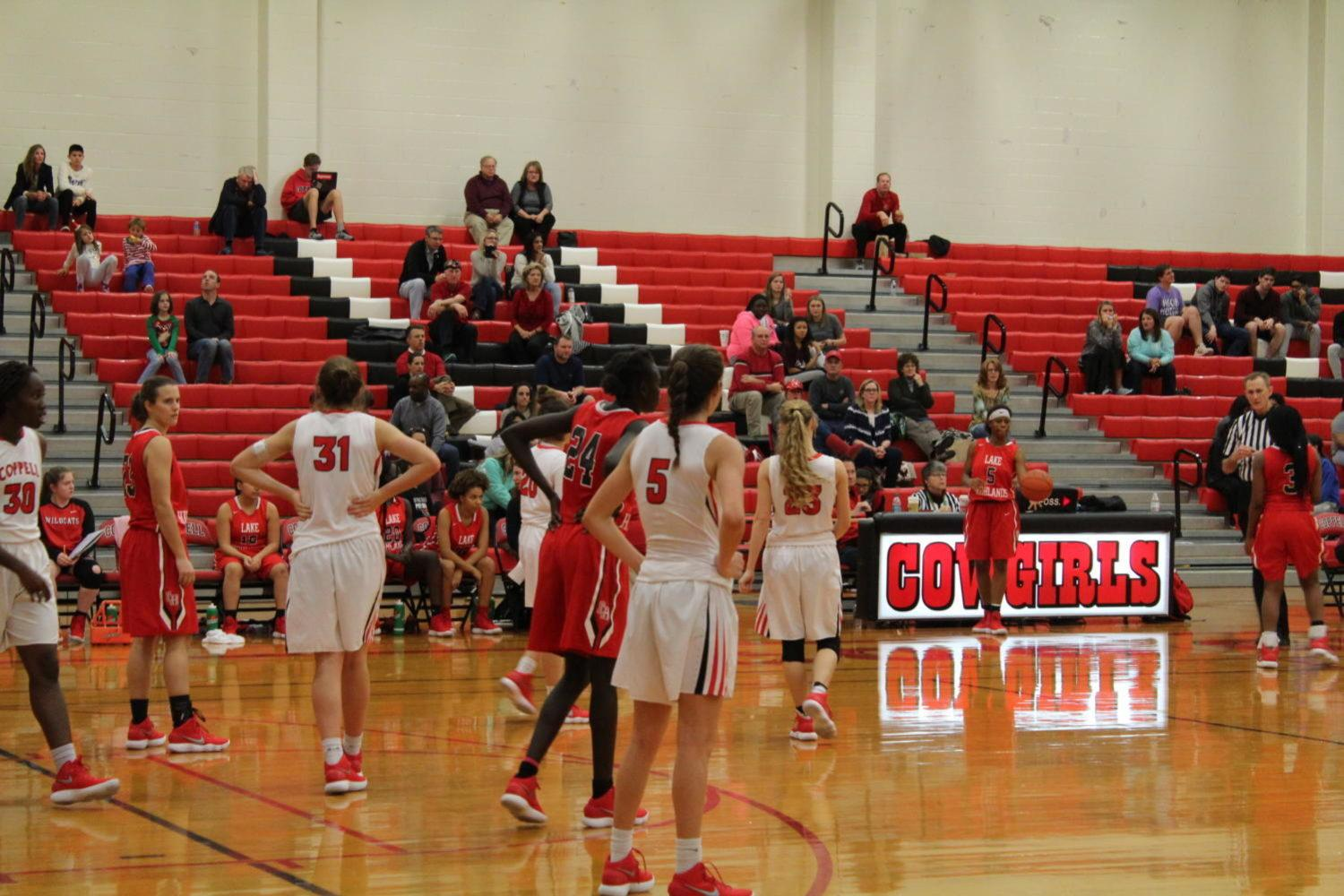 Coppell High School sophomore Chloe Hassman and the rest of the Cowgirls play defense against the Lake Highlands Friday night. The Coppell Cowgirls defeated the Lake Highlands girls basketball team 40-32 making the Cowgirls win their first District 9-6A game of the season in the School's Big Gymnasium