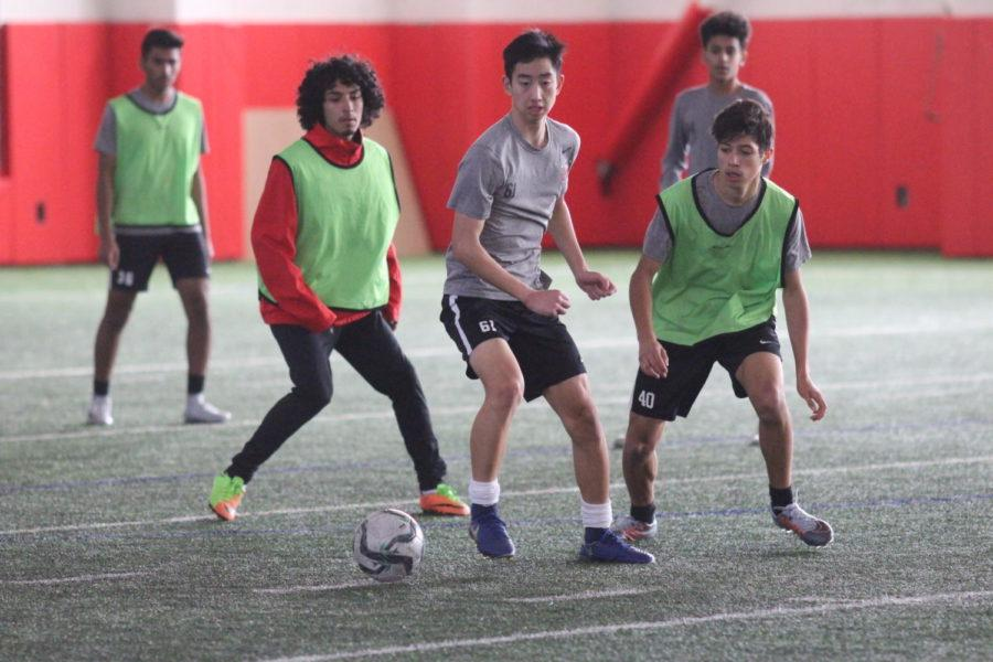 Coppell High School JV boys chase after the ball during third period practice on Jan. 18. The boys junior varsity soccer team practices for their upcoming game against McKinney Boyd High School on Feb. 6.
