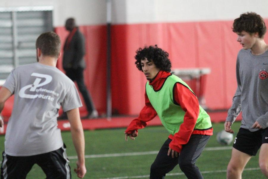 Coppell High School senior Ivan Carrillo and sophomore Maxwell Winneker keep their eyes on the ball during third practice period on Jan. 18. The  boys junior varsity soccer team practices for their upcoming game against McKinney Boyd High School on Feb. 6.