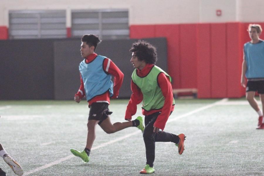 Coppell High School senior Ivan Carrillo runs for the ball in practice during third period on Jan. 18. The boys junior varsity soccer team practices for their upcoming game against McKinney Boyd High School on Feb. 6.