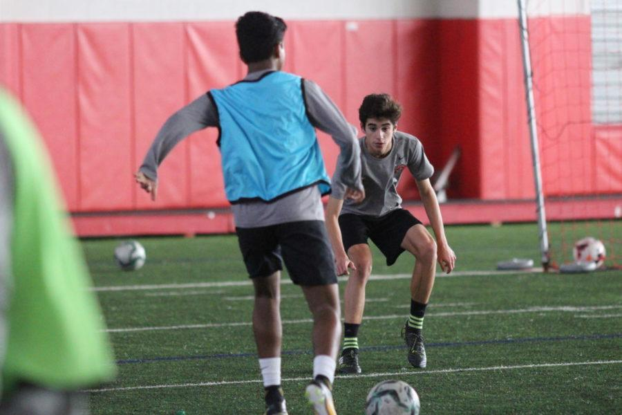 Coppell High School Nicolas Reyes plays defense in practice during third period on Jan. 18. The boys junior varsity soccer team practices for their upcoming game against McKinney Boyd High School on Feb. 6.
