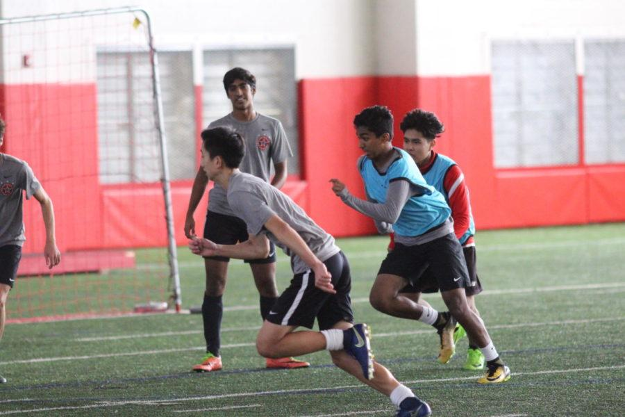 Coppell High School JV boys run to the ball in practice during third period on Jan. 18. The boys junior varsity soccer team practices for their upcoming game against McKinney Boyd High School on Feb. 6.