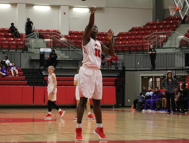 Coppell High School Rachel Okereke shoots a free throw during the second quarter of Friday nights game. The girls varsity basketball team played against Richardson in the arena, Richardson took the win by five points, the final score being 52-57.