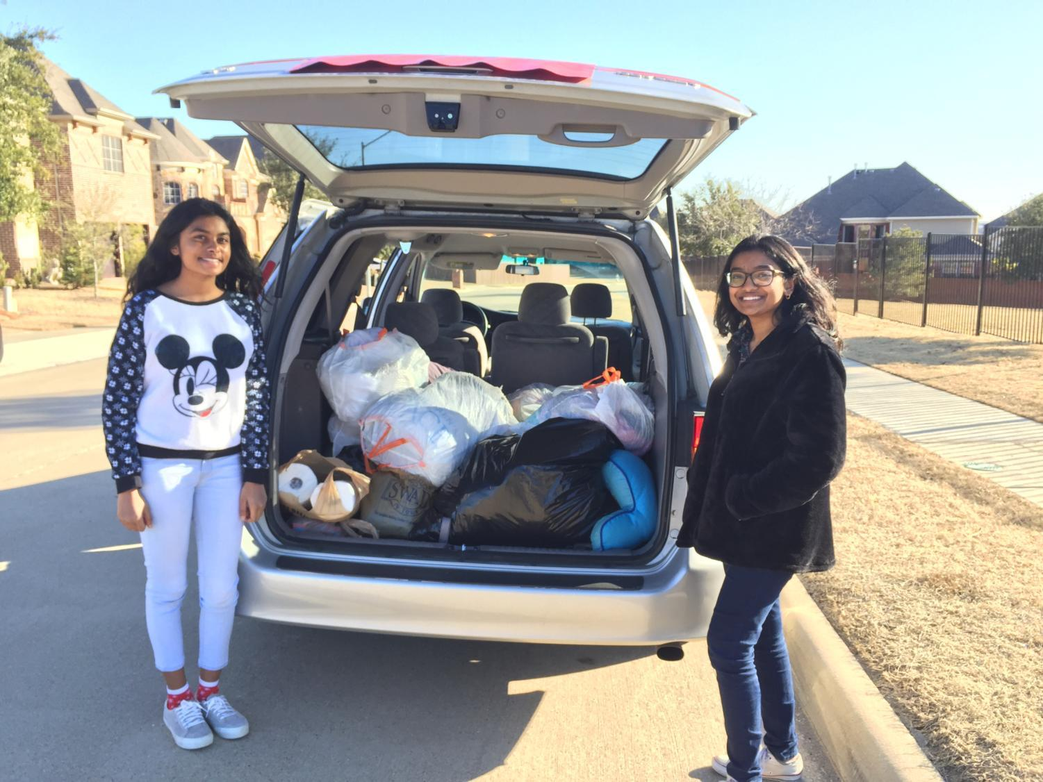 Sophomores Pooja Cheruku and Laasya Madana collect the donations they received through their drive held on Jan. 13. All donations, including clothes and toiletries will be donated to the Salvation Army in order to raise awareness for the issue of homelessness.
