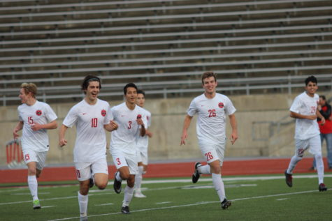 Coppell Cowboys senior midfielder Wyatt Priest celebrates with teammates after scoring the first goal of the tournament game on Jan. 4 at Buddy Echols Field. The Coppell Cowboys defeated the La Joya Huskies 2-0.