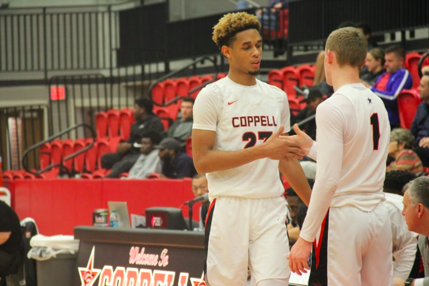 The forward Quevian Adger exchange places with the other player Carter Kryzak at the last half of the game. The Cowboys won with a score of 81-59 against the Berkner Rams team.