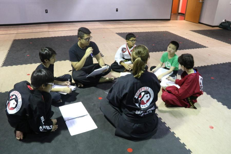 CHS freshman Zan Khan shares goals with his Taekwondo instructor and fellow athletes at Coppell Taekwondo Academy. Khan has been involved with martial arts since age five.