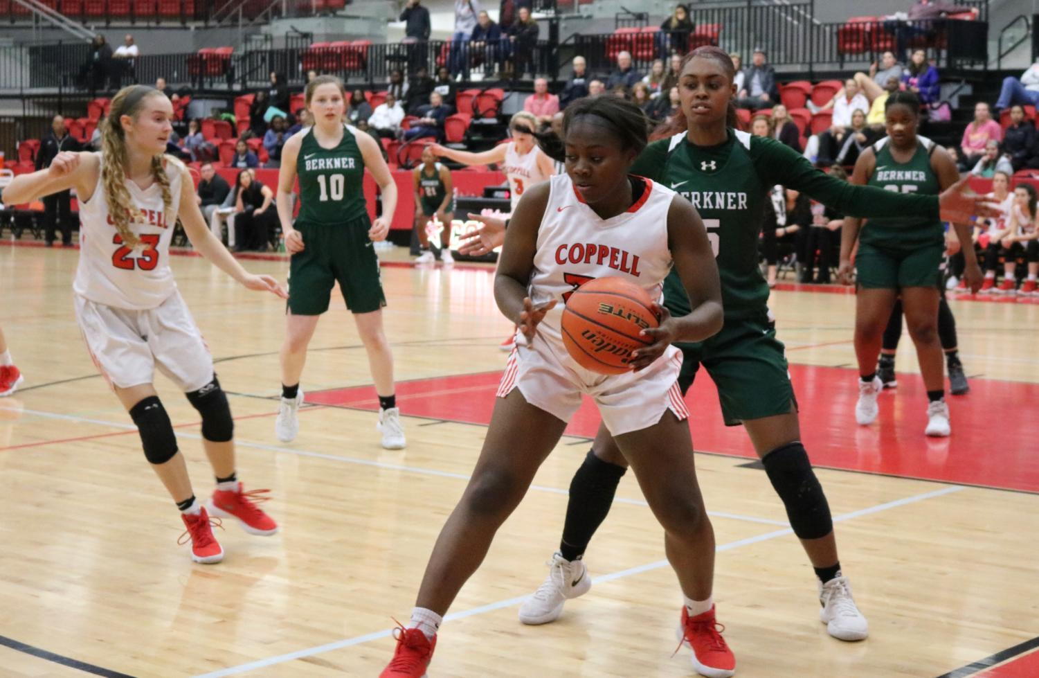 Coppell High School junior center Nicole Obialo boxes out to get a clear pass. The Coppell girls basketball team played against Berkner at the CHS Arena on Tuesday, Feb. 6 winning 58-34, (Sidekick File).