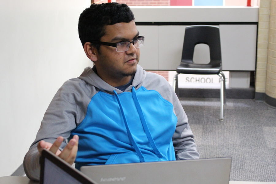 Coppell High School junior Marcus Munshi discusses stories to submit to the Coppell Literary and Art Magazine during creative writing club. The Coppell High School Creative Writing Club meets every Tuesday afternoon in C231.
