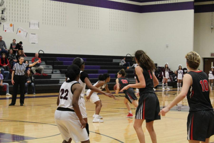 Coppell High School senior Mary Luckett and the rest of the Cowgirls play offense against the Rowlett Eagles Tuesday night at Frisco Independence High School. The Coppell Cowgirls fell short to the Eagles and lost with a close score of 49-40 in the Class 6A girls basketball bi-district game.