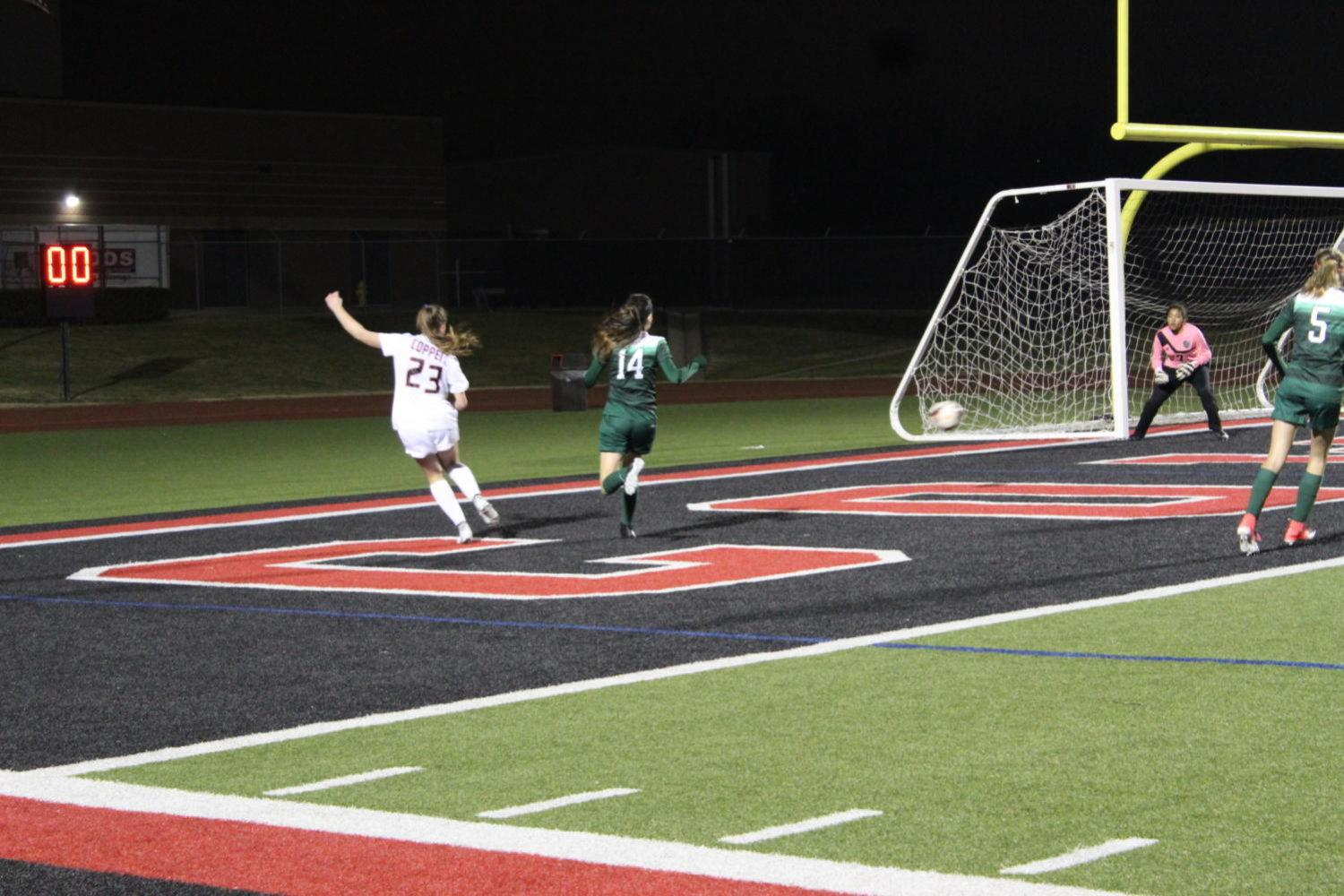Coppell High School girls varsity soccer team went against Berkner High School on Tuesday night. Sophomore Haley Roberson stole the ball from the lady rams and tried to score with a powerful kick. Photo by Quyenh Phang.