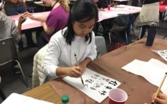 Students practice traditional Chinese calligraphy