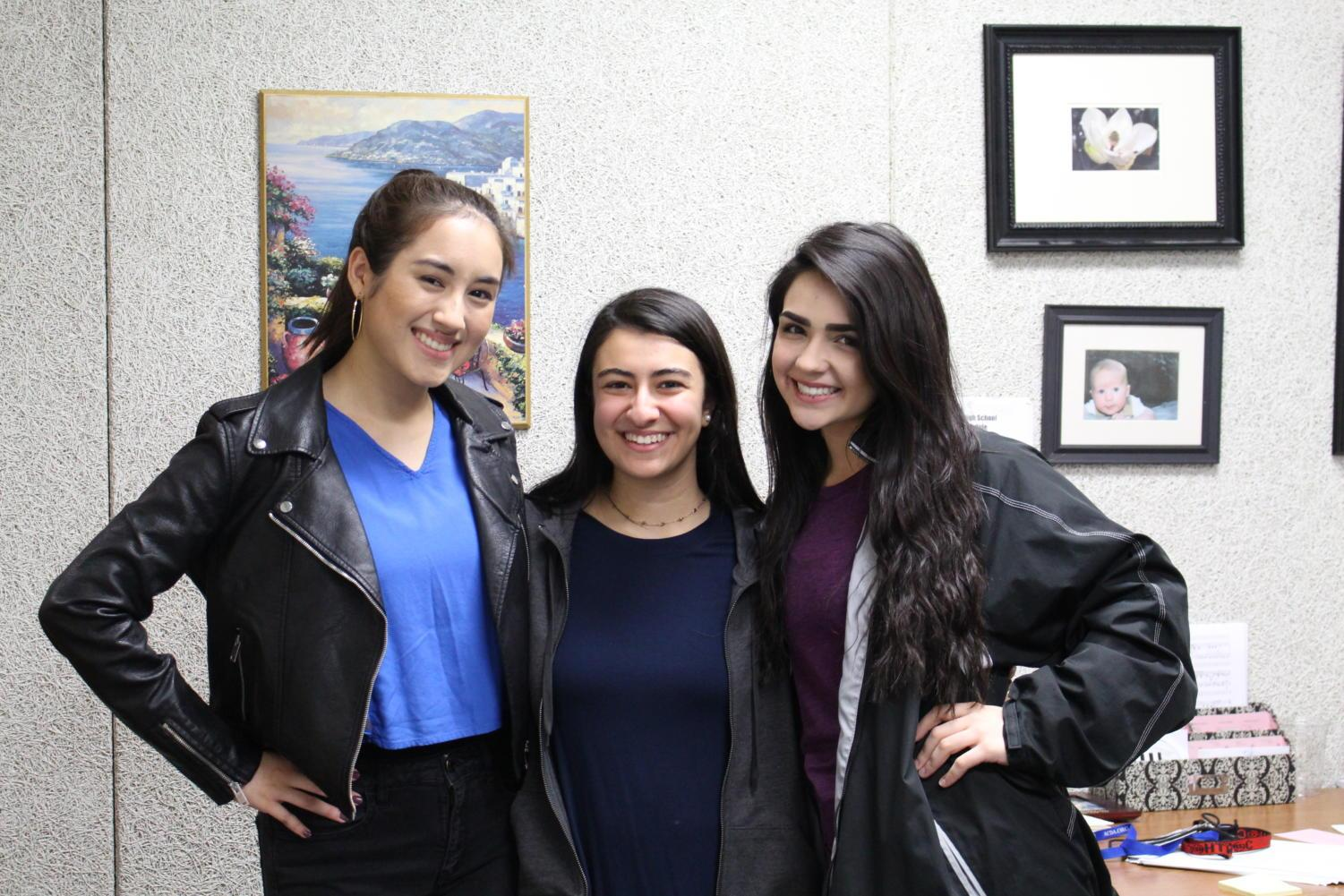 Coppell High School Choir junior Arzue Shakeri, senior Ashley Benhayoun and senior Tori Kennedy smile during 7th period after placing in the All-State Choir. The All-State Choir is a group of highly selected individuals who show certain talents which are brought together to form choirs such as the Treble Choir, Mixed Choir and many more.