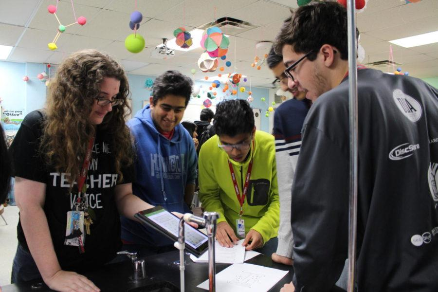 Coppell High School teacher Susan Sheppard who specializes in chemistry shows her third period IB chemistry students what they got wrong on their test. Sheppard's IB chemistry students go over their tests with Sheppard explaining why they got certain questions wrong.