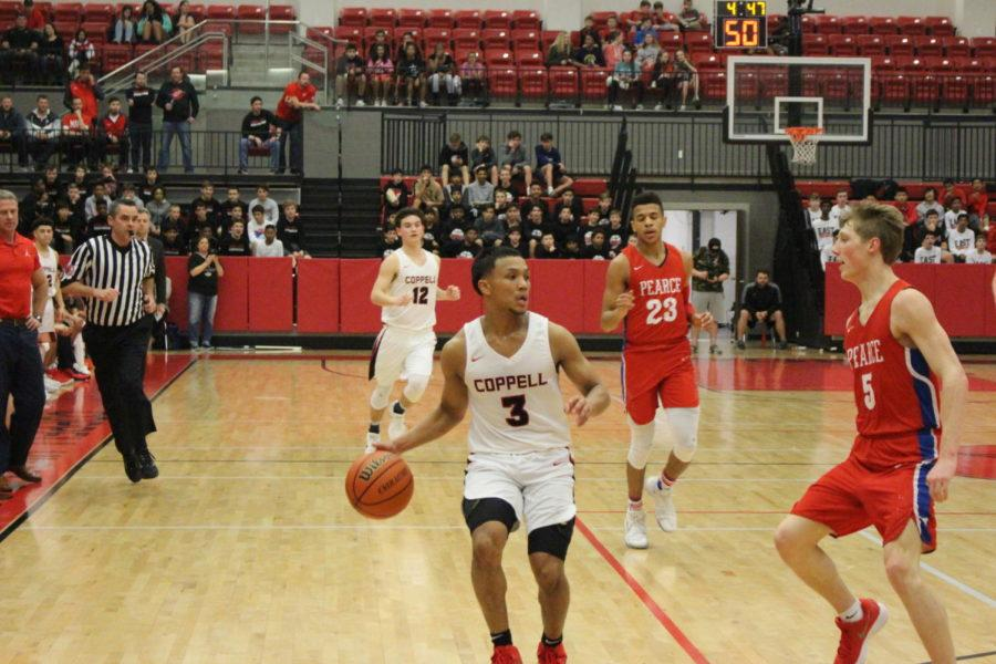 Coppell+High+School+junior+Tariq+Aman+runs+to+the+basket+during+the+first+quarter+of+Friday+nights+game+in+the+arena.+The+varsity+boys+basketball+team+played+against+JJ+Pearce+falling+short+with+a+final+score+of+56-34.+