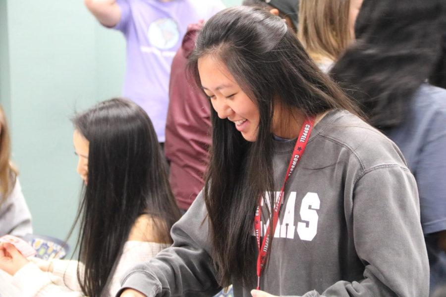 Coppell High School senior Jamie Jun looks at her Valentine gifts at the Red Jacket Valentines Day party in the library during third period today. For the first time, the Red Jackets social committee planned a celebratory party for the hardworking seniors.