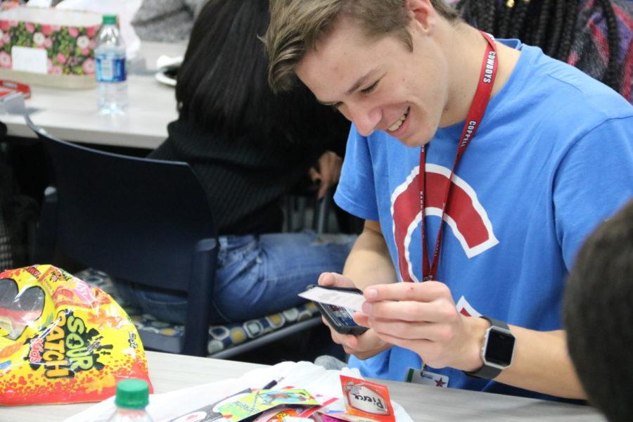 Coppell High School senior Matt Dickens reads his Valentines cards at the Red Jacket Valentines Day party in the library during third period today. For the first, time the Red Jackets social committee planned a celebratory party for the hardworking seniors.