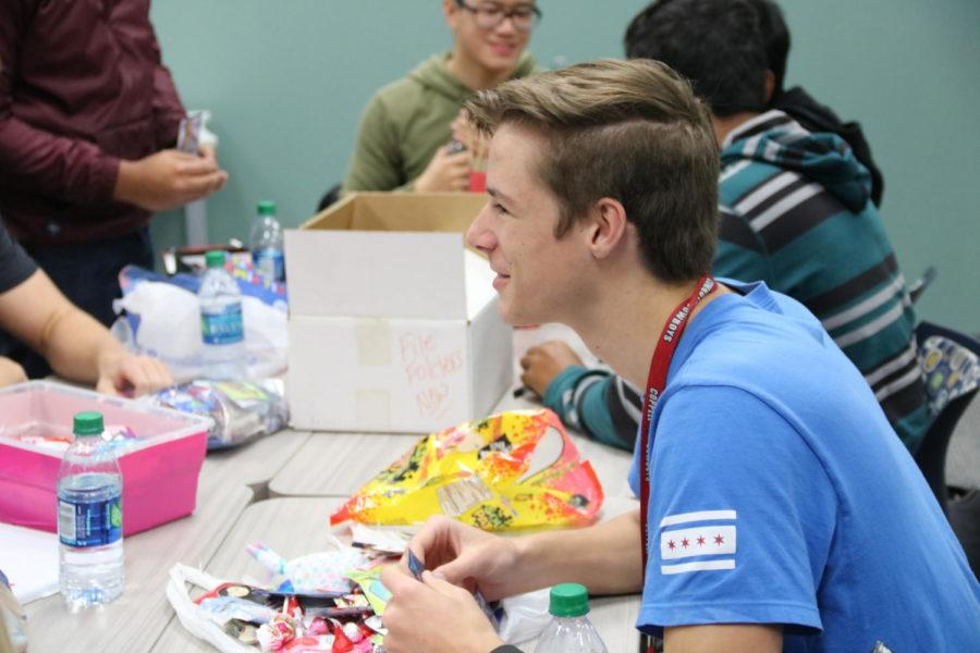 Coppell High School senior Matt Dickens talks with friends at the Red Jacket Valentines Day party in the library during third period today. For the first time, the Red Jackets social committee planned a celebratory party for the hardworking seniors.