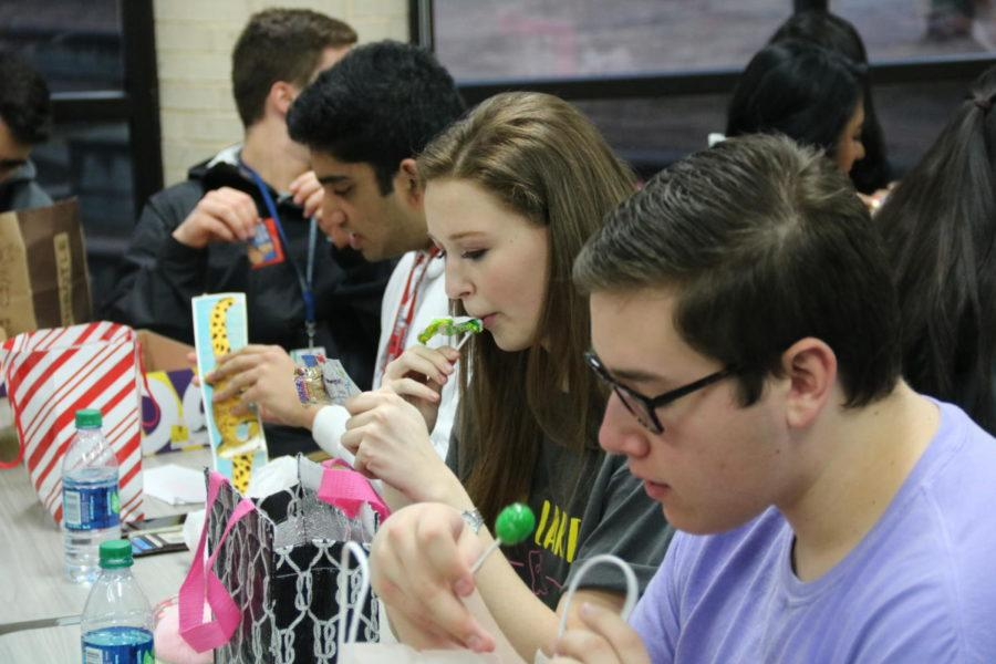 Coppell High School senior Stephanie Wendt looks at her Valentine gifts at the Red Jacket Valentines Day party in the library during third period today. For the first time, the Red Jackets social committee planned a celebratory party for the hardworking seniors.