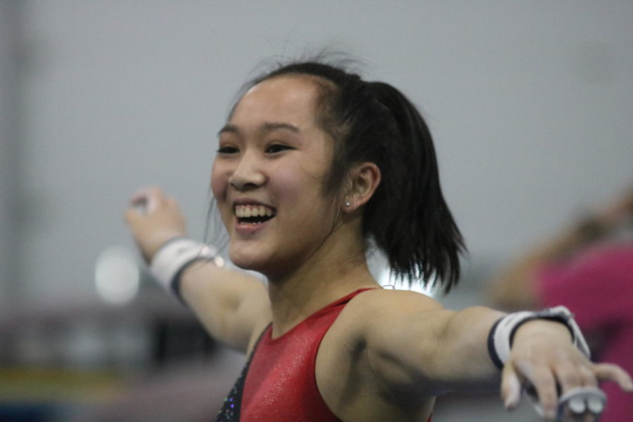 Coppell High School senior Kendal Toy smiles after successfully landing her gymnastics routine during practice on Feb. 14 at Metroplex Gymnastics. Toy committed to the University of Washington for gymnastics in 2014 and received a full scholarship.
