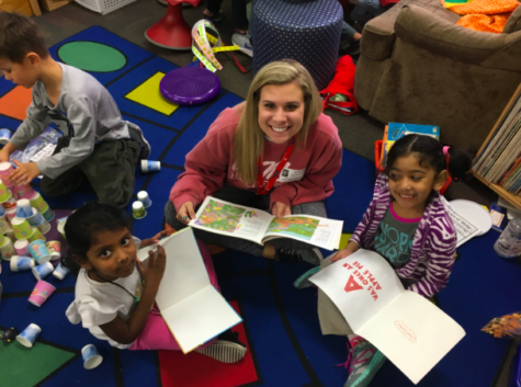 Coppell High School senior Grace Mobley reads with kindergartners at Mockingbird Elementary on Tuesday. Mobley is part of the Ready, Set, Teach! program at CHS which allows students to go to elementary schools and teach children.