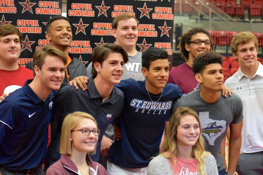 Coppell athletes smile for the camera after signing their letters of intent during the National Signing Day on Feb. 7. Athletes are looking forward to playing at their intended college this upcoming semester in order to pursue their passions.