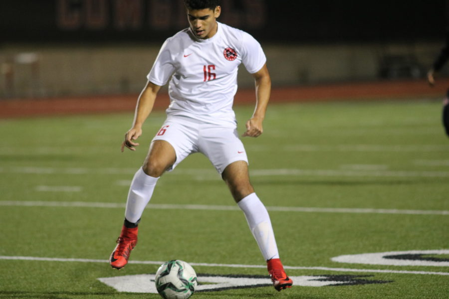 Coppell+Cowboys+senior+forward+Francisco+Redondo+gets+ready+to+make+a+pass+during+the+first+half+of+the+game+on+Feb.+9+at+Buddy+Echols+Field.+The+Coppell+Cowboys+defeated+the+WT+White+Longhorns+2-1.+