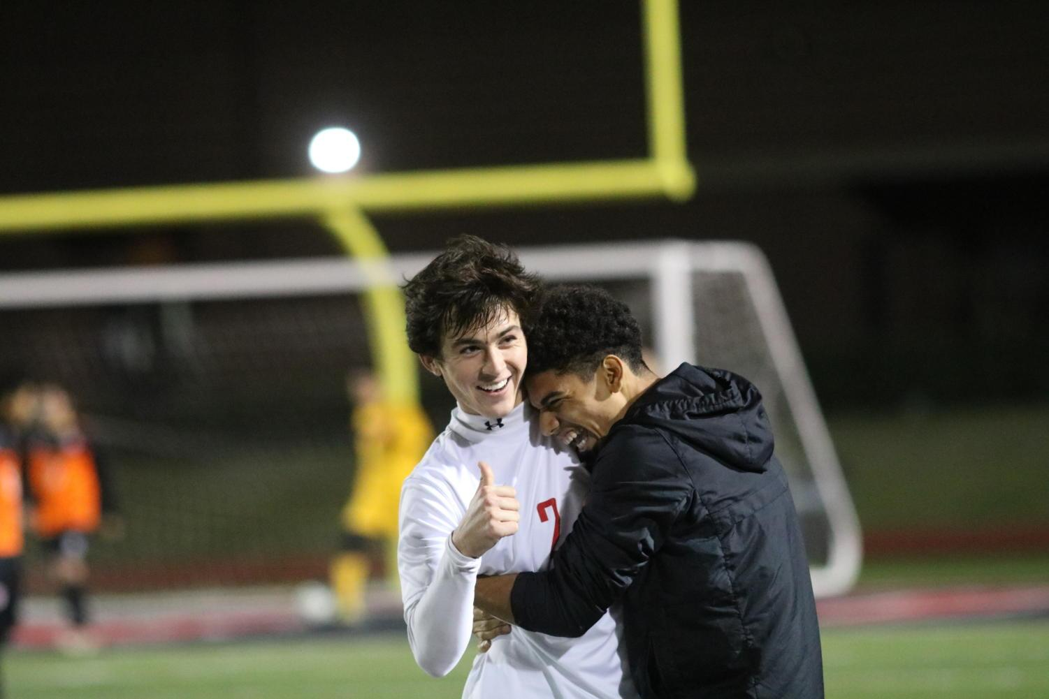 Coppell Cowboys senior forward Francisco Redondo hugs senior fullback defender Marshall Board after he makes a goal during the second half of the game on Feb. 9 at Buddy Echols Field. The Coppell Cowboys defeated the WT White Longhorns 2-1.