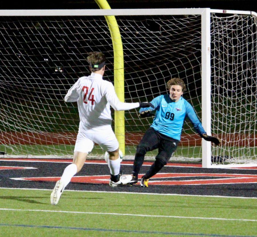 Coppell High School junior defender Jeremy Basso successfully shoots the ball for a goal during the first half of the game on Feb. 21 at Buddy Echols Field. The Coppell Cowboys defeated  Richardson 6-1 as they look forward to their next game against Jesuit.