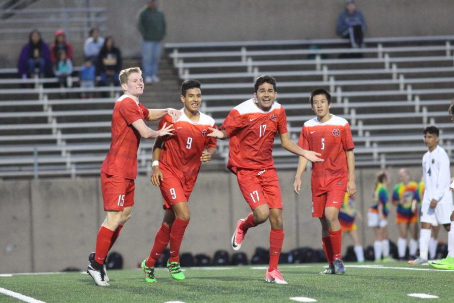 Coppell Cowboys (from right to left) senior defenders Jacob Turman and Juan Pablo Rodriguez celebrate with senior midfielders Byron Peng and Amit Verma after Verma made an unexpected goal during the last five seconds of the game on March 30 at John Clark Stadium in Plano. The Coppell Cowboys defeated the Garland Owls, 4-0, in the bi-district round of the Class 6A Region I playoffs.