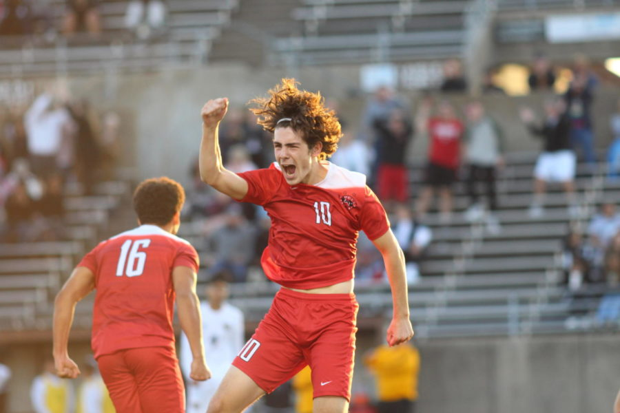 Coppell+Cowboys+senior+midfielder+Wyatt+Priest+jumps+with+joy+after+assisting+a+goal+during+the+second+half+of+the+game+on+March+30+at+John+Clark+Stadium+in+Plano.+The+Coppell+Cowboys+defeated+the+Garland+Owls%2C+4-0%2C+in+the+bi-district+round+of+the+Class+6A+Region+I+playoffs.+